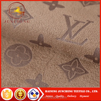 Embossed fashion design synthetic upholstery suede fabric for sofa and upholstery