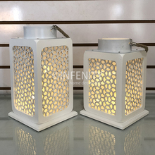 White hurricane lantern with LED Candle lights,chunky rope handle good for home lighting