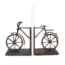bicycle shape cast iron bookends on desk with bronce color