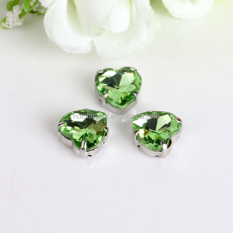 machine cut peridot green color heart shape sew on crystal stone in claw for women dresses