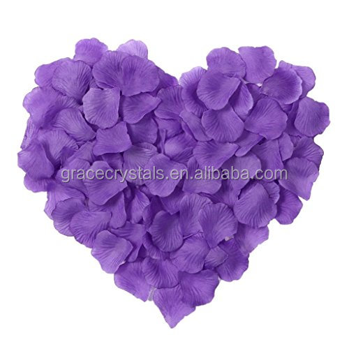 Purple wedding decoration scatters fabric rose petals