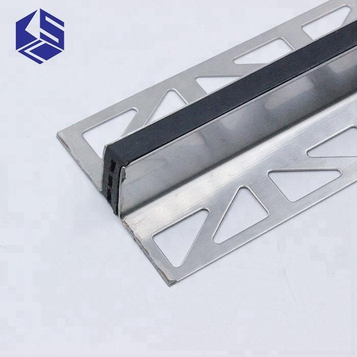 Stainless steel tile expansion joint for concrete floor