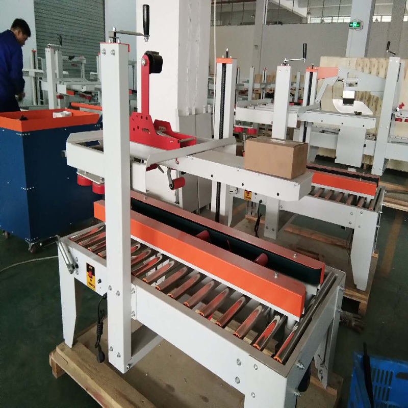 FM-FX500A  Adhesive Tape High  Carton Sealing Machine  Cardboard Box Sealer Top and Bottom Belt Drive