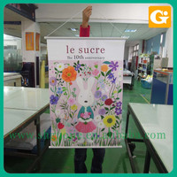 Vertical hanging banner for advertising with plastic scroll