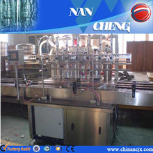 China Manufacturer Linear Type Automatic Glass Bottle Coconut Oil Filling Packing Machine