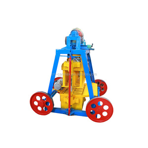 best selling manual brick making machine QT4-45 / low investment high profit business with concrete mixer