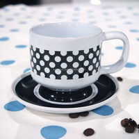 Black white ceramic coffee cup and saucer