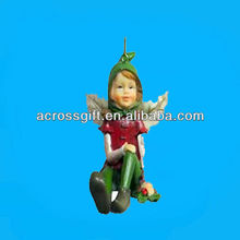 polyresin fairy sitting handing ornament