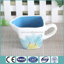 color glazed ceramic coffee creamer with hand painting design