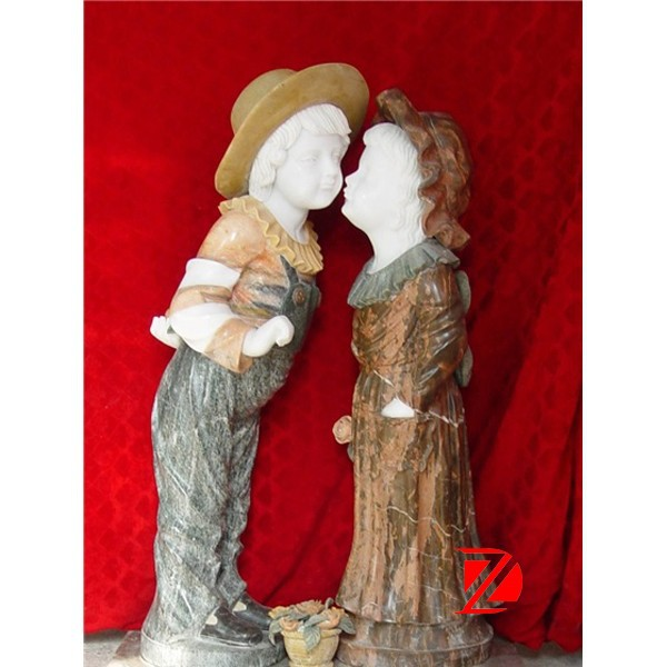 stone kissing boy and girl statue