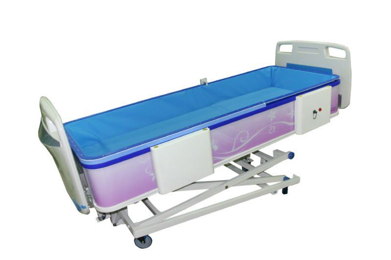 A bed with bathtub - hospital equipment