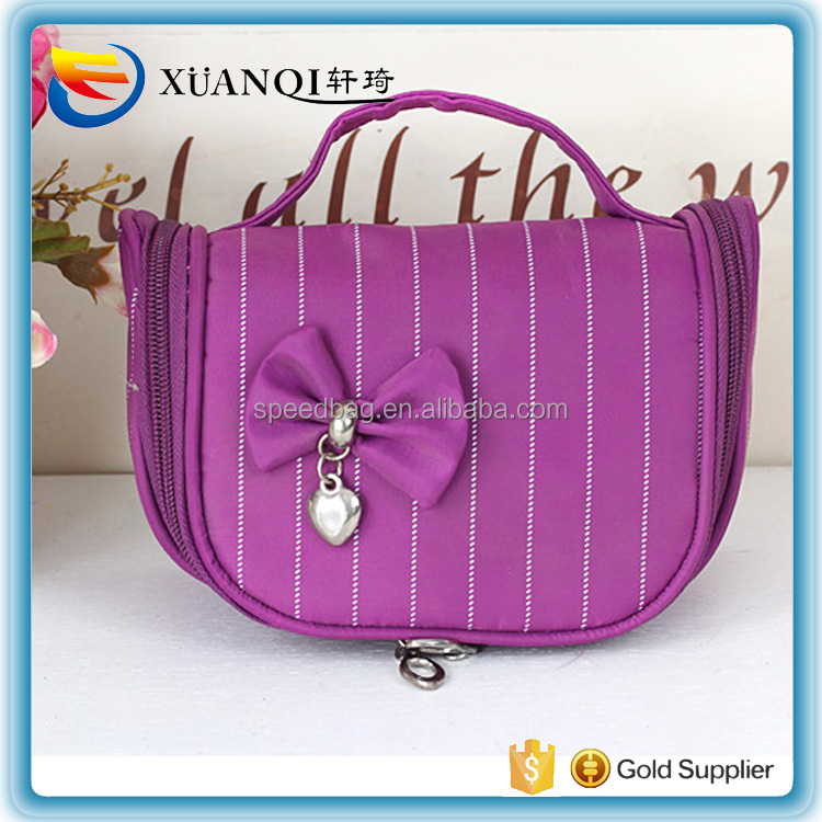 Beautiful satin material cosmetic bag with bowknot