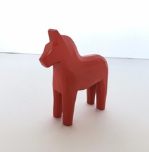 Red decorative shape wooden horse