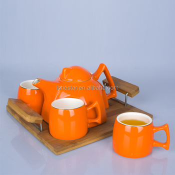 Wholesale orange tea pot and cups set with wood pandle