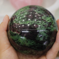 Carved polished epidote gemstone sphere