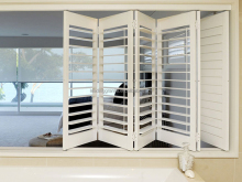 Wood interior bi-fold window shutters