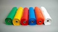 disposable cheap colorful PE Plastic apron on roll