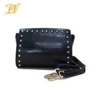 2014 Alibaba china wholesale ladies online shopping fashion brand leather wing shoulder bag with rivets