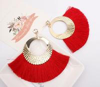 Fringed earrings, fan shaped tassels, gold diamond earrings.
