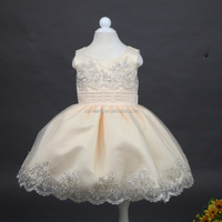 baby boutique frock cream color laced for flower girls latest dress design
