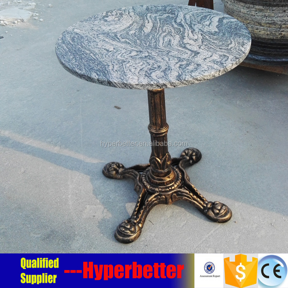 Sunset granite table top with cast iron table leg