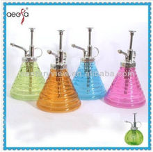 Pyramid/round shaped colored tabletop using glass watering pot