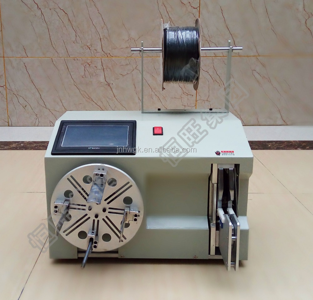 Small toroidal inductor coil winding machine with coil