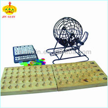 Gambling bingo game set for leisure time with bingo board, bingo pieces,cards and cage