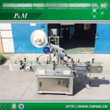 Automatic horizontal labeling machine for plastic bottles and bags