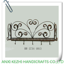antique wrought iron wall rack with hooks