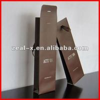 Brown long gift paper bag for packing red wine
