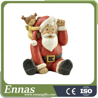 Polyresin hot sale of sitting santa with girl for christmas gifts