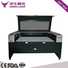 K-1310 1300*1000mm co2 fabric national flag laser cutting machine