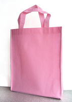 Portable standard size nonwoven shopping bag