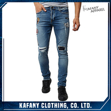 Mens Blue wash ripped patterned badge Sid skinny jeans