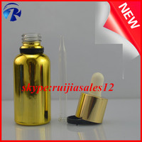 Golden perfume glass bottles with metal/ 30ml golden glass bottle with gold&silver cap and bulb glass dropper
