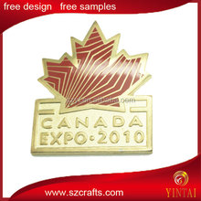 maple leaf printed gold plated badge