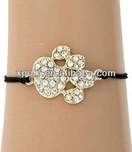 Gold Plated And Cheap Clear Rhinestone Paw Print Themed Friendship Cord Bracelet