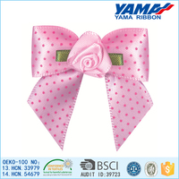 Pink white ribbon bows with polka dots design