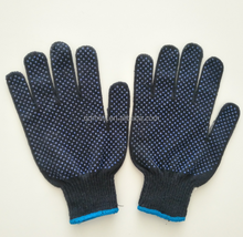 Polyester/cotton seamless inspection work glove with PVC dot coating for exceptional grip and handling ability