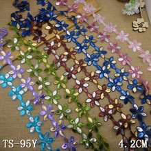 The daisy flower pink blue gold brown green purple blue silver sequin lace