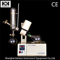 Vacuum glass chemical distillation device with oil bath