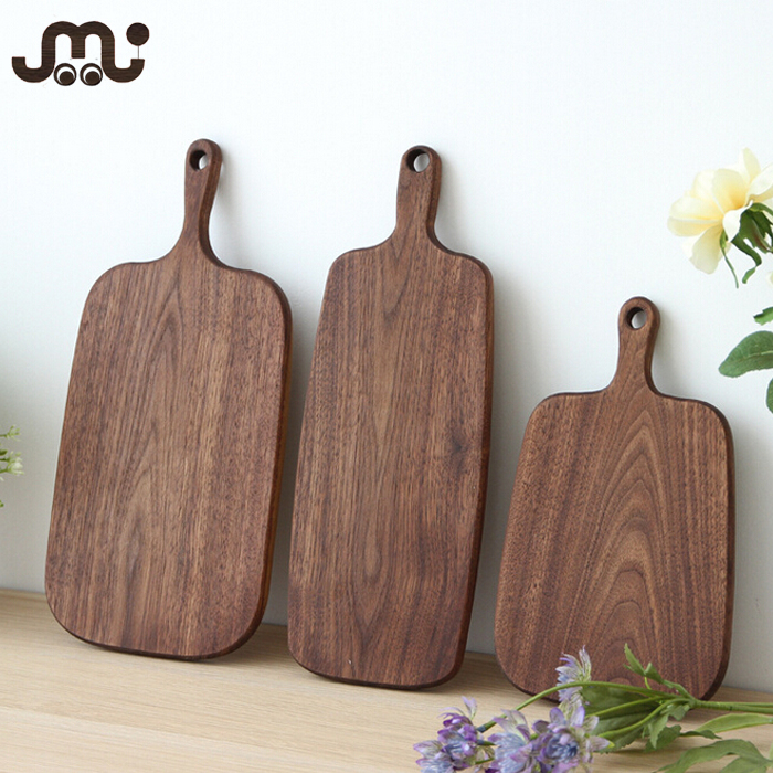 Natural waxed walnut wooden cutting board