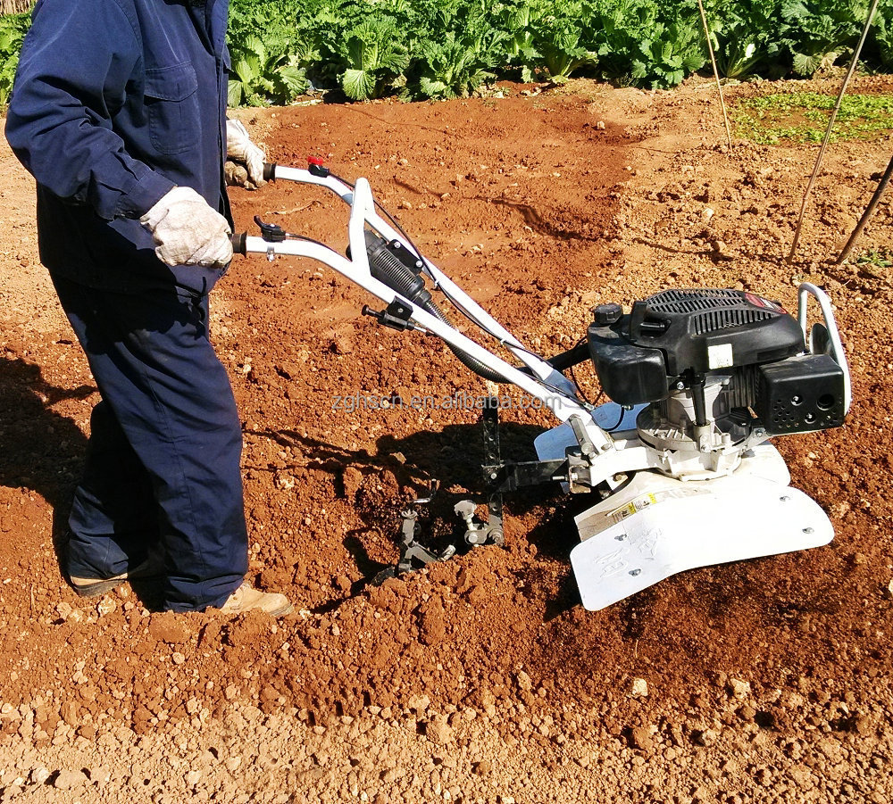Small field garden mini tractor rotary cultivator for Small hand held garden tools