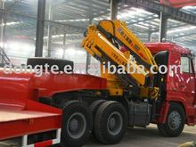 steyr tractor head mounted 12ton crane(with low bed semi trailer)contact Mr. Tom song king 24 hours phone:TEL:+8615271357675