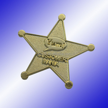 custom embossed metal star with gold color