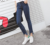 Wholesaling jeans women long skinny denim jeans pants with raw flared hem from Guangzhou xintang town