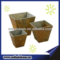 Green plants flowers pots yellow rusty slate natural stone planters