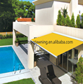 Motorized folding arm awnings