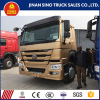 China Left hand drive 6x4 SINOTRUK HOWO tractor truck for sale in Ghana